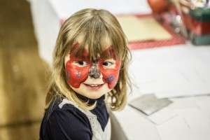 Face painting at the 2015 Christmas Grotto Event at the Ile Youth & Community Centre